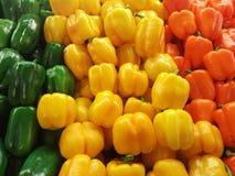 Peperoni gialli ed arancio verdi Immagine Stock