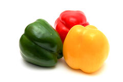 Peperoni Multi-colored su una priorità bassa bianca Fotografia Stock Libera da Diritti