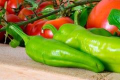 Peperoni och tomater Arkivfoto