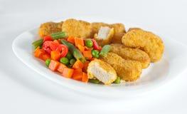 Pepitas com salada Imagens de Stock