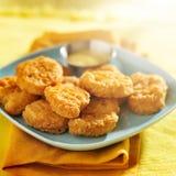 Pepitas de galinha com molho de mostarda do mel Imagem de Stock Royalty Free