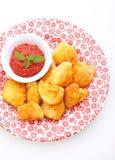 Pepitas de galinha com molho de tomate Fotografia de Stock Royalty Free