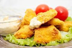 Pepitas de galinha fritada Imagens de Stock