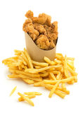 Pepitas de pollo y patatas fritas foto de archivo