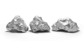 Pepitas de prata em um fundo branco Foto de Stock Royalty Free