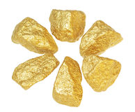 Pepitas del lingote de oro. Foto de archivo libre de regalías