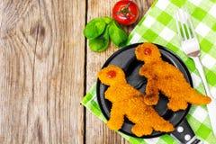 Pepitas dos peixes para dinossauros das crianças Fotos de Stock Royalty Free