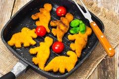 Pepitas dos peixes para dinossauros das crianças Imagem de Stock