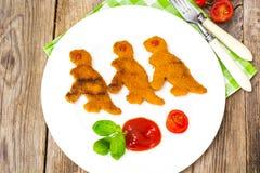 Pepitas dos peixes para dinossauros das crianças Fotos de Stock