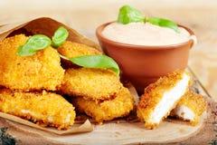 Pepitas e molho de galinha Imagem de Stock Royalty Free