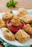 Pepitas fritas con la salsa de tomate Imagen de archivo libre de regalías