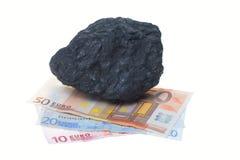 Pepitas y billete de banco del carbón Fotografía de archivo libre de regalías