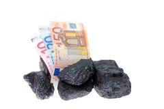 Pepitas y billete de banco del carbón Fotos de archivo