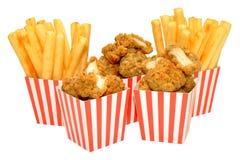 Pepitas y fritadas de pollo Imagenes de archivo
