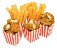 Pepitas y fritadas de pollo Foto de archivo libre de regalías