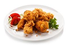 Pepite di pollo fritto immagini stock libere da diritti