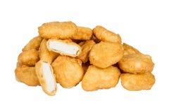 Pepite di pollo fritto marroni dorate Immagine Stock Libera da Diritti
