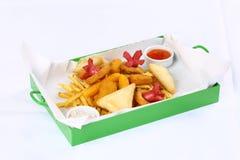 Pepite e patate fritte Fotografie Stock Libere da Diritti