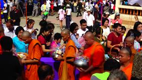 Peple give food offerings to Buddhist monks. stock video footage