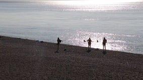 Peplestrand bij zonsondergang stock videobeelden