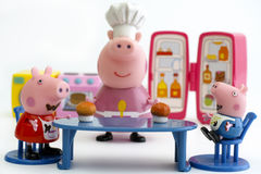 Peppa Pig and George Pig eating cupcakes Stock Photos