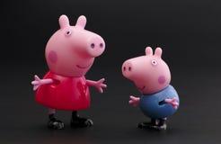 Peppa svin och George Pig Arkivbild