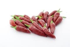 Peppar för röd chili i ett hjärtabildande Royaltyfria Foton