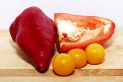 Peppar och tomates Fotografering för Bildbyråer