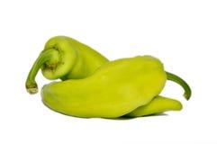 Peppar på vit bakgrund arkivfoton