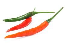 Peppar på vitbakgrund Arkivfoton