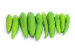 Peppar som är varm och som är kryddig på vit bakgrund royaltyfria foton