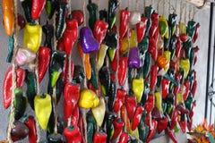 Peppar som hänger i väggen Royaltyfria Foton