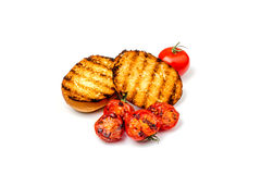 Pepparbröd med körsbärsröda tomater Arkivbild