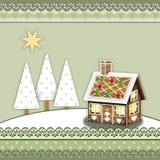 Pepparkakahus i ett kort för winterlandscapejulhälsning i scrapbooking stil för tappning arkivbild