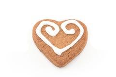 Pepparkakakakahjärta på vit fotografering för bildbyråer