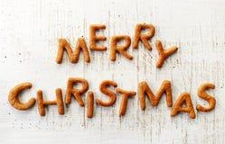 Pepparkakan uttrycker glad jul royaltyfria bilder