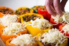 Peppars com queijo na parte superior Imagem de Stock
