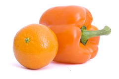 Pepper. Fresh pepper and mandarin on isolated background Royalty Free Stock Image
