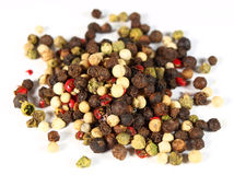 Pepper. Heap of colored pepper isolated on white royalty free stock photo