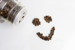 Pepper. This image is of a smiley face composed of black peppercorn Royalty Free Stock Images