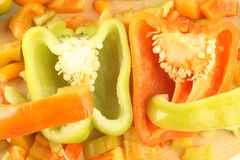 Orange and green pepper sliced. Slices of peppers closeup Royalty Free Stock Image