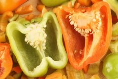 Orange and green bell peppers. Pepper. Slices of sweet green and orange pepper Royalty Free Stock Photo