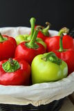Pepper. A lot of red and green peppers on a wooden table stock photography