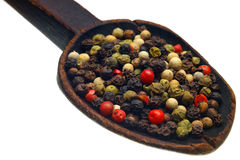Pepper. Color peppercorns on wooden spoon Royalty Free Stock Photo