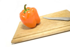 Pepper. One large pepper lies on a wooden kitchen blackboard for cutting Royalty Free Stock Photography