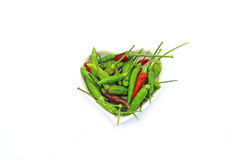 Pepper. In bowl heart on white background Stock Images