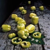 Pepper. Yellow bell peppers on rustic table Stock Image