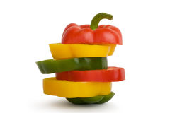 Pepper. Green, red and yellow pepper slices isolated on white background Stock Photos