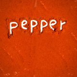 Pepper abstract. Abstract background made of pepper powder with text Stock Images