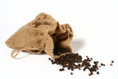 Pepper Bag 2. Black pepper spilling out of a small hessian bag Stock Image